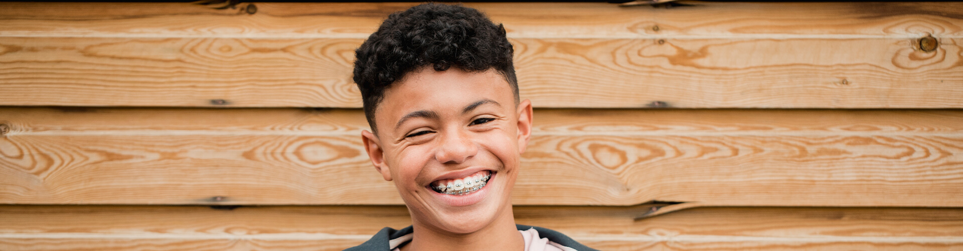 smiling young man with braces